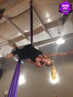 Blonde Woman on silks at Miss Fit Academy