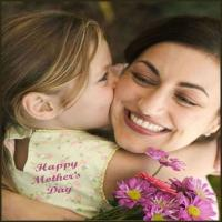 little girl giving her mom flowers on Mother's Day