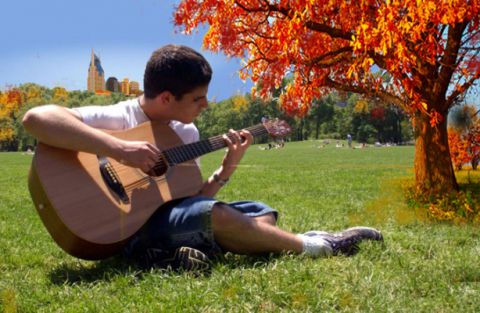 Young man playing the guitar in Nashville area park