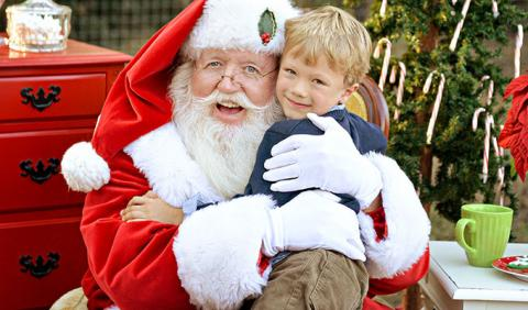 Little Boy getting his picture with Santa Claus