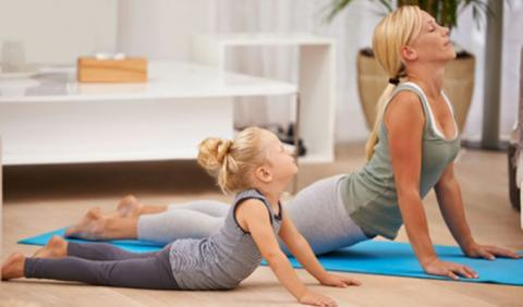 Mother and Daughter practicing yoga in Nashville