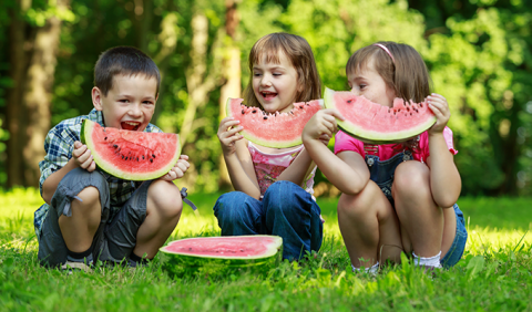 Kids eating watermelon at 4th of July Celebration in Nashville and middle Tennessee
