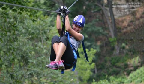 Girl Zip LIning in one of Nashville's Parks