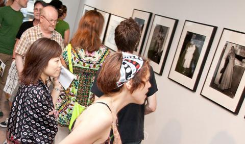 Crowd admiring art in Nashville Art Event